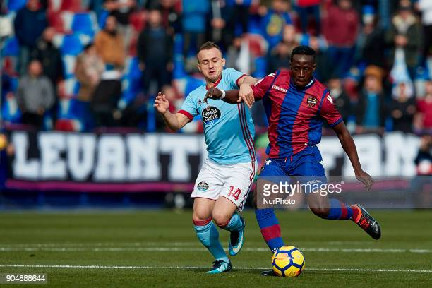 Boateng of Levante UD competes for the ball with Stanislav Lobotka of Real Club Celta de Vigo during the La Liga game between Levante UD and Real...
