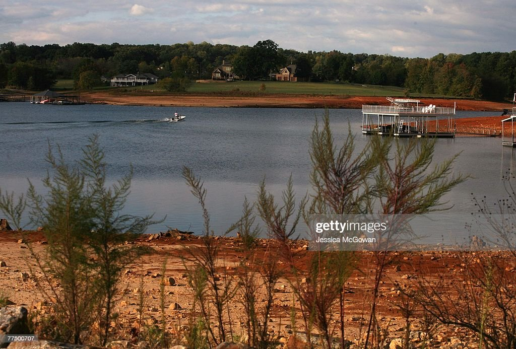 A boater passes dried banks near Lake Lanier's Young Deer