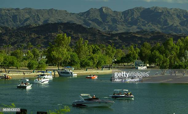 Boaters enjoy a calm day cruising through the London Bridge channel before the July 4th Independence Day weekend at Lake Havasu Az Wednesday June 30...