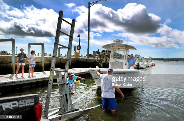 Boaters got an early start getting their boats out of the water on August 20, 2021 at the Mattapoisett boat ramp in Mattapoisett Harbor on the South...