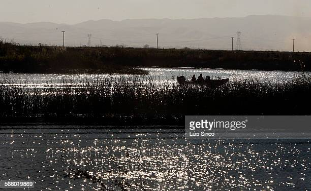 Boaters navigate the MIddle River between Bacon Island and Lower Jones Tract in the Sacramento River Delta near Stockton Calif Levees in the area...