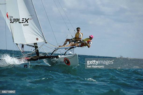 Boaters on Catamaran During Race
