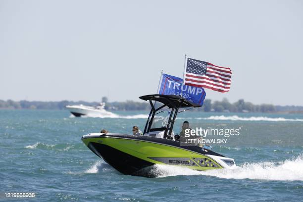 Boaters participate in the Make america Great Again parade as they celebrate US President Donald Trump's 74th birthday on the Detroit River in...