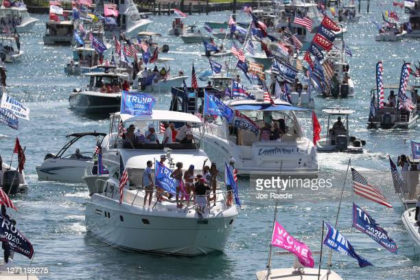 Boaters show their support for President Donald Trump at the start to a parade down the Intracoastal Waterway to just off the shore of President...