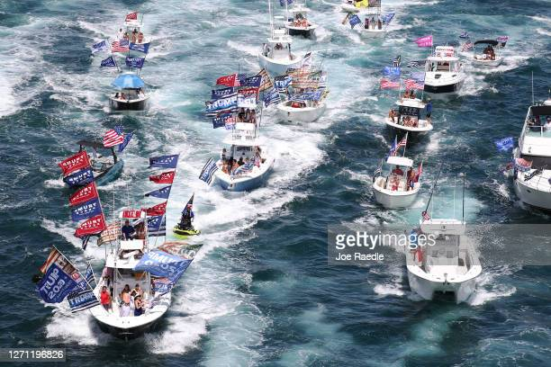 Boaters show their support for President Donald Trump during a parade down the Intracoastal Waterway to just off the shore of President Trump's home...