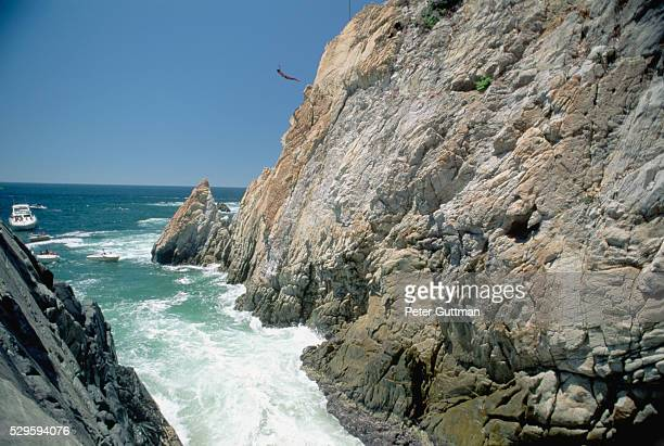 boaters watch cliff diving in mexico - acapulco stock pictures, royalty-free photos & images