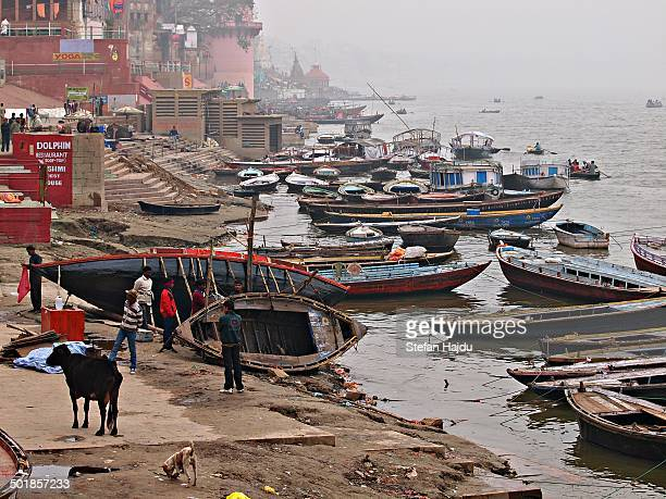 CONTENT] Boates on the river Ganga at the holy city of Benares