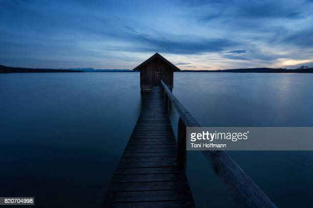 Boathouse at a moody evening at lake Ammersee