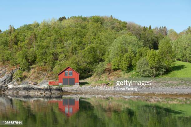 Boat-house by the side of a fjord at Leka Island, Norway.