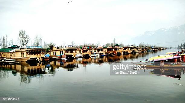 boathouses in dal lake against sky - kashmir valley stock photos and pictures