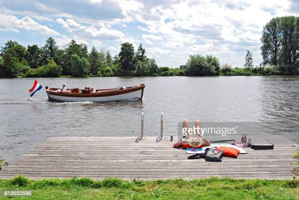 Boating and sunbathing along the wijde Aa