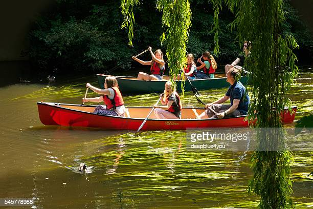Boating in canoes on the river Bille
