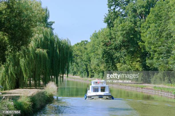 boating on the canal latéral à la loire - canal stock pictures, royalty-free photos & images