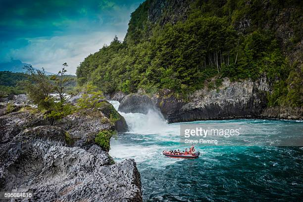 boating on the petrohue river in chile. - petrohue river stock photos and pictures