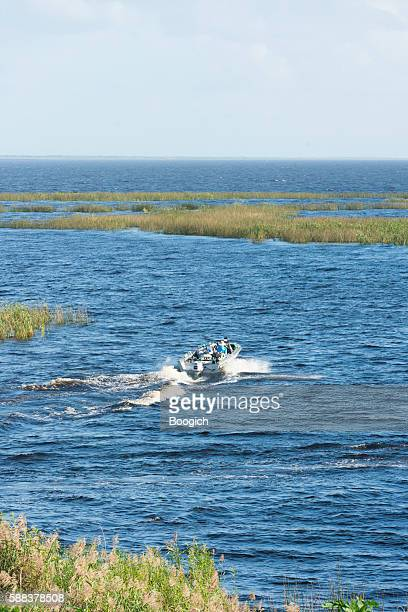 boating on the water of lake okeechobee canal florida usa - lake okeechobee stock pictures, royalty-free photos & images