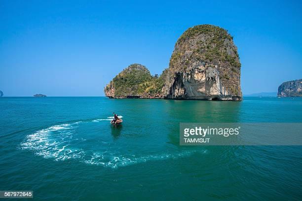Boating with beautiful island in Andaman Sea