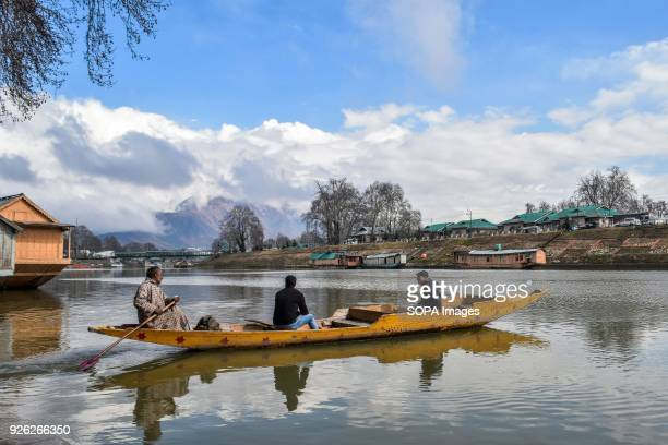 A boatman ferry passengers on a partly cloudy day in Srinagar Indian administered Kashmir Ahead of prediction of rain and snow from Thursday due to a...