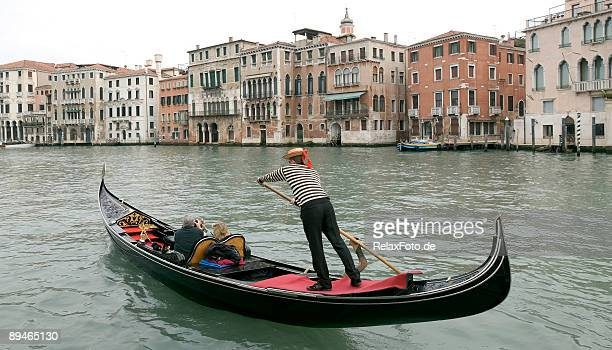 Boatman in a gondola on the Grand Canal in Venice