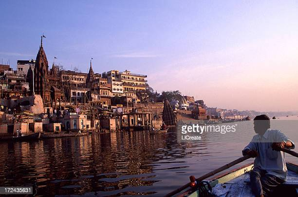 boatman on the ganges river at dawn. varanasi, india - shiva stock pictures, royalty-free photos & images