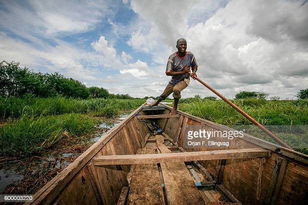 Boatman Ousman pushes his boat through tall grass near Guité in the overgrown Lake Chad The lake has shrinked to a twentieth of the size it was in...