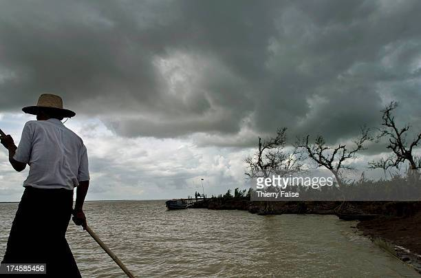 A boatman pushes his boat along a bank of the Irrawaddy River According to official figures the cyclone killed about 140000 people on May 2 and 3 2008