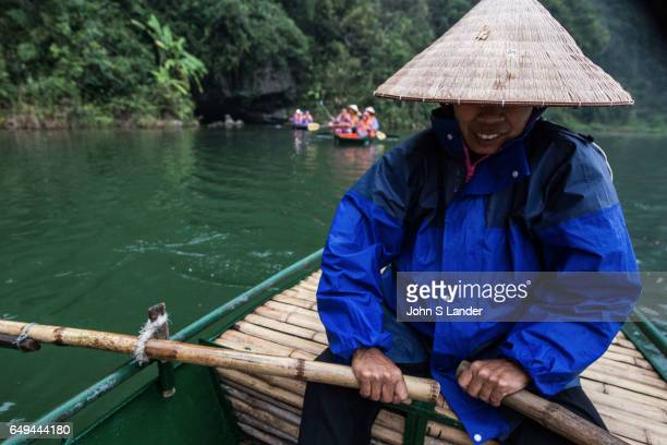 Boatman with Conical Hat at Trang An Complex Trang An Landscape Complex is made up of three distinct areas Hoa Lu Ancient Citadel Trang An and Tam...