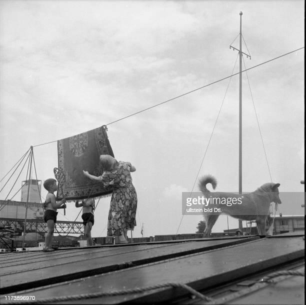 A boatman's family woman and children aboard a ship Rhine port Basle 1954