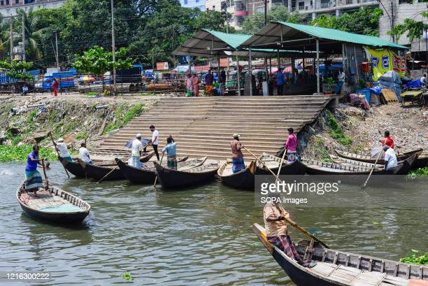 Boatmen are seen waiting for passengers as the boat terminal reopens after the Coronavirus lockdown crisis. Bangladesh government is likely to end...