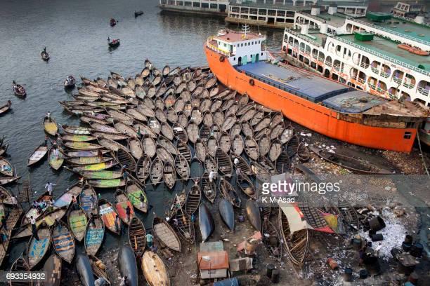SADARGHAT DHAKA BANGLADESH Boatmen are waiting beside the Burigonga River on the day before of World Environment Day A large swathe of the Buriganga...