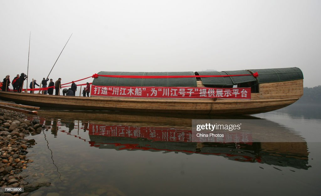 Boatmen push a replica of an ancient Chuanjiang Boat to the Fujiang River during a launch ceremony of the boat on February 18, 2008 in Tongliang County of Chongqing Municipality, China. The boat, measured about 23 meters long and 4.2 meters wide, weighing about 50 tons, was built by Chinese man Ou Zurong, who spent 220,000 yuan (approximately USD 30,986) and over three months to finish the work with the help of a group of carpenters. It will be developed as a tourist attraction on the Yangtze River. Chuanjiang Boat is a traditional transportation on the Yangtze River which has vanished for decades.