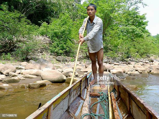 Boatmen Sengkham rests after pulling the boat up the rapids on the Nam Ou river during the dry season when the river level is low Phongsaly province...
