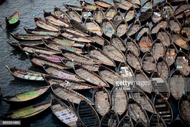SADARGHAT DHAKA BANGLADESH Boatmen wait for passengers beside the Burigonga River on the day before of World Environment Day A large swathe of the...