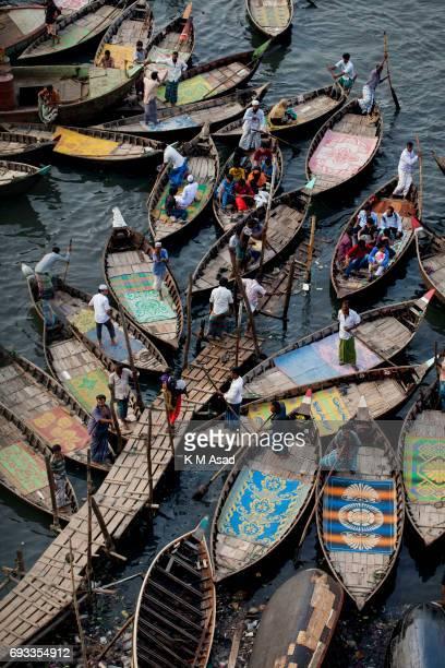 SADARGHAT DHAKA BANGLADESH Boatmen wait to transport passengers beside the Burigonga River on the day before of World Environment Day A large swathe...