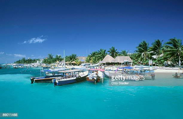 boats along coast in yucatan, mexico - isla mujeres ストックフォトと画像
