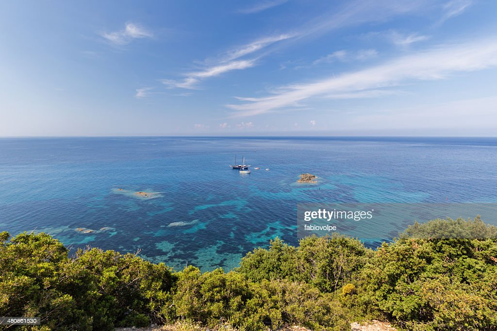 boats among the coral sea : Stock Photo
