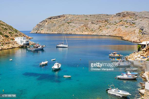 Boats anchored in the port of Cheronissos during midday on June 18 2015 in Sifnos Greece Sifnos is a island in the western Aegean Sea the surface...