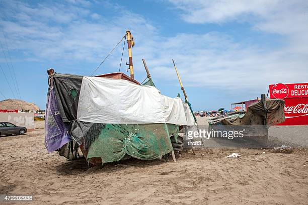 boats and beach cafe at the beach on peruvian coast - tarpaulin stock pictures, royalty-free photos & images