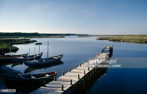 Boats and dock on the Sado river Sado Estuary Nature Reserve Baixo Alentejo Portugal