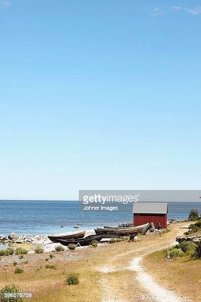 Boats and fishing shed at sea