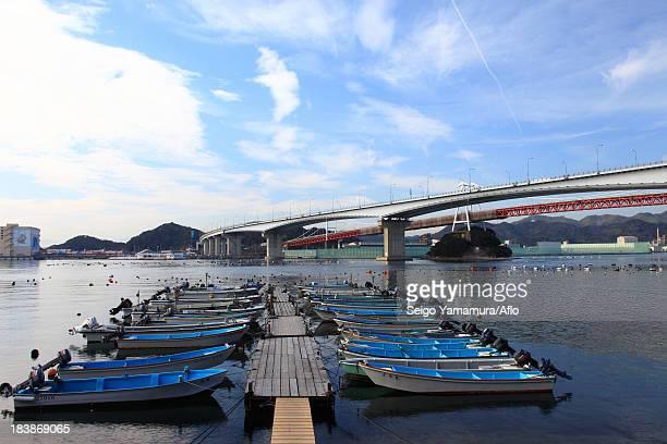 boats and konaruto bridge, tokushima prefecture - naruto stock photos and pictures