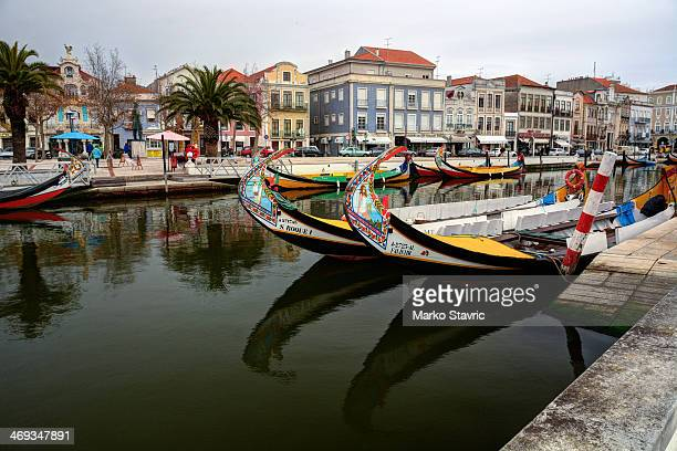 Boats and palm trees reflected in the central canal of Aveiro. Aveiro is often referred to as the Venice of Portugal.