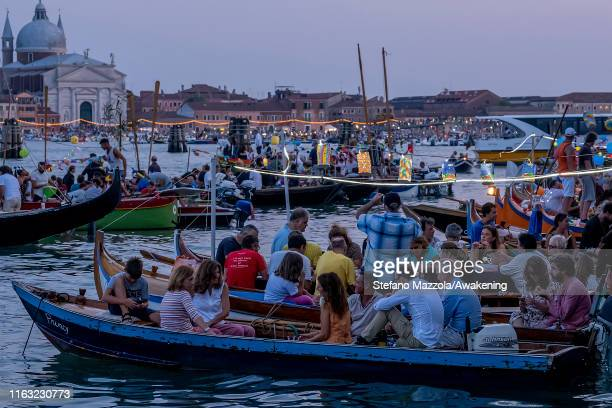 Boats and partygoers gather in St Mark's Basin and Giudecca Canal on the day of the Redentore Celebrations on July 20 2019 in Venice Italy Redentore...