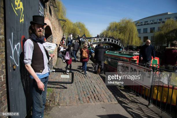 Boats and people at Camden Lock a busy hang out for young Londoners and tourists in Camden Town London England United Kingdom Camden Town is famed...