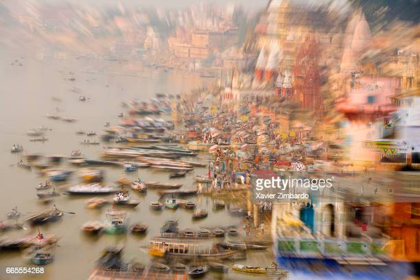 Boats and pilgrims on the banks of River Ganges the most sacred river of Hindus on October 24 2005 at Varanasi Uttar Pradesh India