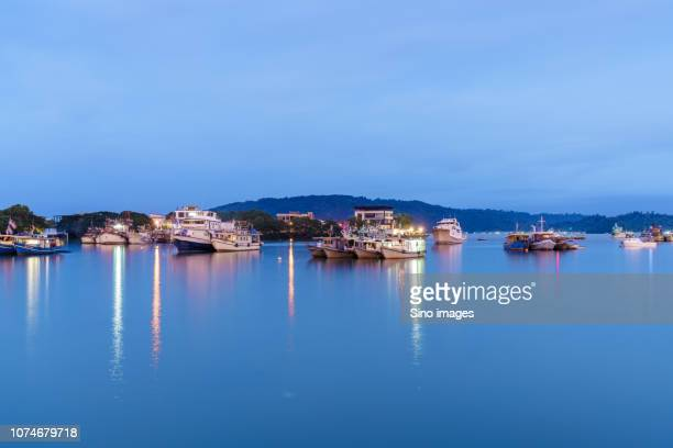 boats and ships in sea at sunset, sabah state, malaysia - state stock pictures, royalty-free photos & images