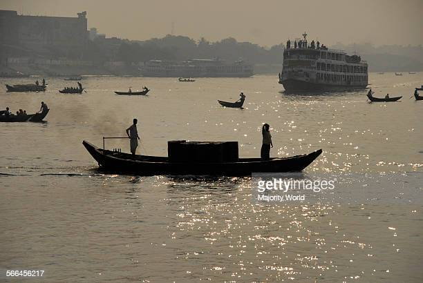 Boats and steamers ply on the Buriganga the main river that flows through Dhaka the capital city of Bangladesh The river is economically very...