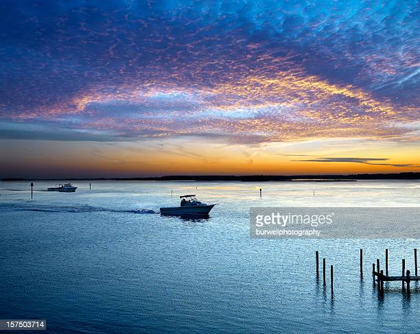 boats and sunset on the water - chesapeake bay stock pictures, royalty-free photos & images