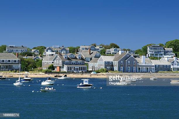 Boats and waterfront Houses, Nantucket, Massachusetts. Clear blue sky.