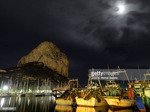 boats and yachts moored in the harbor at night - calpe stock pictures, royalty-free photos & images