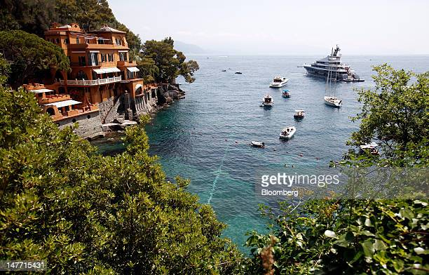 Boats and yachts sit moored in the sea at a cove near Portofino Italy on Saturday June 30 2012 Italy's economy will shrink 24 percent this year twice...